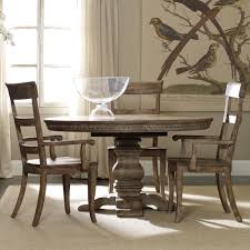 casual dining set with round pedestal table ladderback arm chairs