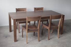 solid walnut parsons dining table customizable with leaves
