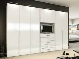White Laminate Floor White Wooden Wardrobe With Racks On Brown Wooden Laminate Floor