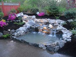 pretty flower garden ideas dashing pond with stone material and beautiful flower garden idea
