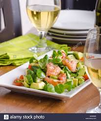 fresh lamb lettuce salad with avocado cucumber salmon cherry