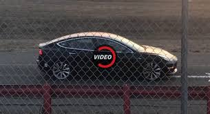 tesla model 3 spotted with red brake calipers is it the long