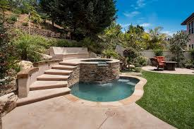 tuscan style natural small inground swimming pool with concrete