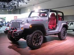 jeep lifted pink jeep wranglers rubicon with tires on a lift carstrucks lifted yahoo