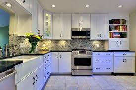 kitchen cabinets white cabinets slate floor drawer knobs oak
