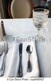 water glasses on table setting place setting and water glass silverwear a folded napkin
