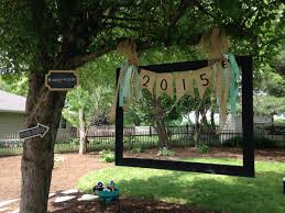 homemade photo booth old picture frame hung with burlap and a few