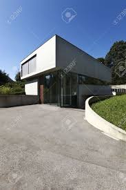 entrance of a modern house in beton stock photo picture and