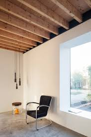 chris collaris architects builds black wooden cottage with
