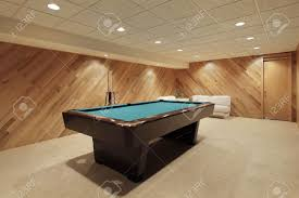 Wood Pool Table Pool Table In Suburban Home With Wood Paneling Stock Photo