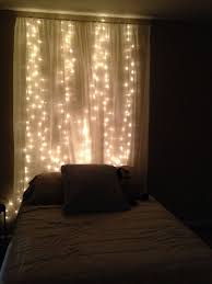 sheer curtains with lights string lights behind sheer curtain headboard love this idea for