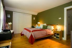 green best paint colours for bedrooms with brown wooden floor of