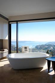 20 luxurious bathrooms with a scenic view of the ocean wonderful framing of the distant view turns the minimal bathroom into a relaxing retreat design