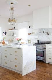 silver under cabinet range hood black quartz countertop green
