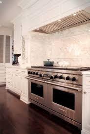 custom range hood in white kitchen mahshie custom homes cool