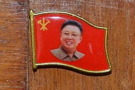 scores of kim jong il badges found at hotel near incheon airport