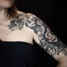 etching or woodcut blackwork tattoo mainly roses and smaller