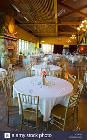 tables and seating for an indoor wedding reception in a craftsman