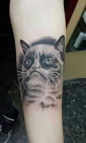 realistic grey ink grumpy cat tattoo on arm by atomic tattoo