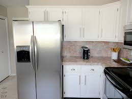 diy kitchen remodel with white painting oak kitchen cabinet with diy kitchen remodel with white painting oak kitchen cabinet with door and drawer combined with marble backsplash and countertop plus refrigerator for very