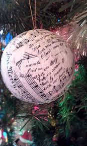 paper mache ornament ball decorated with vintage sheet music