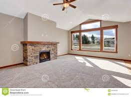 livingroom carpet fireplace living room unfurnished with carpet stock photo