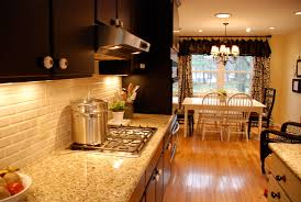 Backsplash With Venetian Gold Granite - dare you to paint your cabinets black emily p freeman