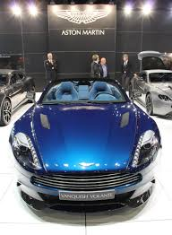 logo aston martin vanquish in ocellus teal front with logo aston martin com