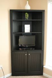 black corner media storage cabinet with doors and shelves