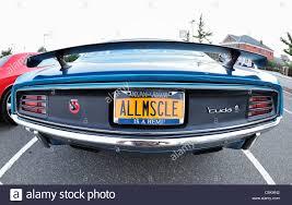 ny vanity plates plymouth baracuda muscle car rear with