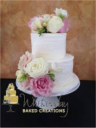 2 tier wedding cake with fresh flowers two tier round white