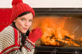 happy warming up by home fireplace wear sweater