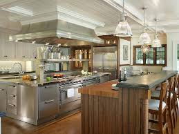 stainless steel kitchen island with dual stove and hood