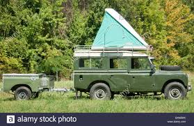 jeep roof top tent land rover with roof top tent and trailer stock photo royalty