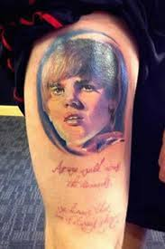 weird and a little scary tattoos of justin bieber popstartats