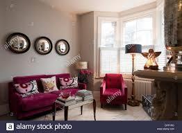 Mirrors In Living Room Raspberry Coloured Velvet Furniture In Living Room With Graham And