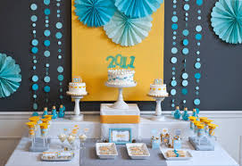 high school graduation party supplies the backdrop for this table also party tables