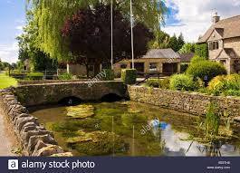 country houses the river thames flowing past cotswold stone country houses in the