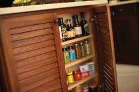 Wall Mount Spice Cabinet With Doors The End Of An Island Is A Great Place To Tuck A Spice Rack In A