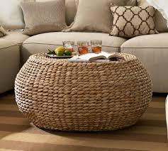round rattan cocktail table on brown carpet tiles for living room
