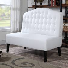 white upholstered dining bench with tufted back of photo on