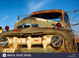Old Ford Truck Motors - old ford truck rusting in a field stock photo royalty free image