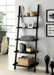 decorating black wooden ladder bookshelf before the grey wall