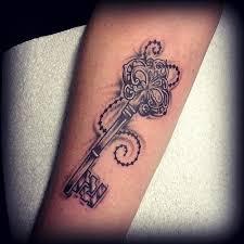 skull lock and key on forearm