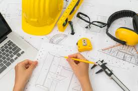 construction plans construction plans with yellow helmet and drawing tool