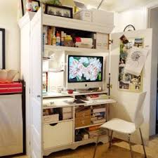 white large computer armoire with pull out keyboard desk and