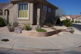 a desert southwest landscaped front yard corner lot with ocotillo