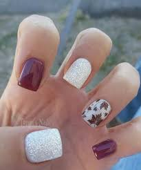 16 fall manicure with red white and silver nails and a leaf accent