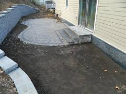 Paver Patio With Retaining Wall by Paver Patio Contractor Rosemount Mn Devine Design Hardscapes