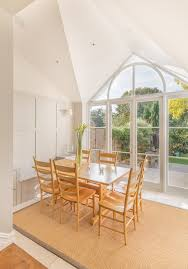 Painted Wall Paneling by Dining Pitched Roof Extension Vaulted Ceiling Painted Wall